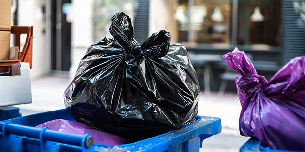 Close up of trash bags filled with trash after cleaning the environment.
